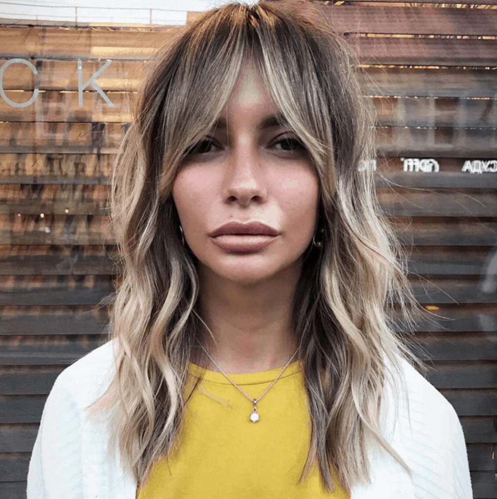 Layered hairstyle with bangs
